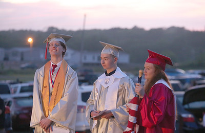 Salutatorian Vance Fowler stands with student council vice president Anthony Bedel and treasurer Julia Hart at Slippery Rock High School's graduation ceremony at the Starlight Drive-In Thursday. Seb Foltz/Butler Eagle