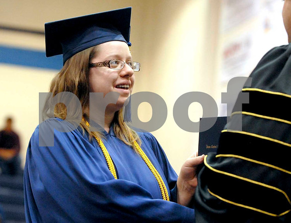 -Messenger photo by Hans Madsen<br /> <br /> Lois Raner, of Duncombe, accepts her diploma Saturday morning during the 46th annual Iowa Central Community College commencement. Raner graduated from the graphics technology program.