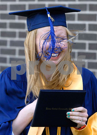 -Messenger photo by Hans Madsen<br /> <br /> The wind gives Emily Laughlin, of Fort Dodge, a bit of trouble with her tassle Saturday morning as she celebrates her graduation from Iowa Central Community College.