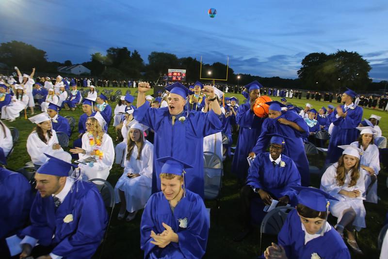 Beachballs fly during much of Dracut High School graduation. (SUN/Julia Malakie)