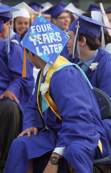 Dracut High School graduation. Brian Bettencourt's message on his cap. (SUN/Julia Malakie)