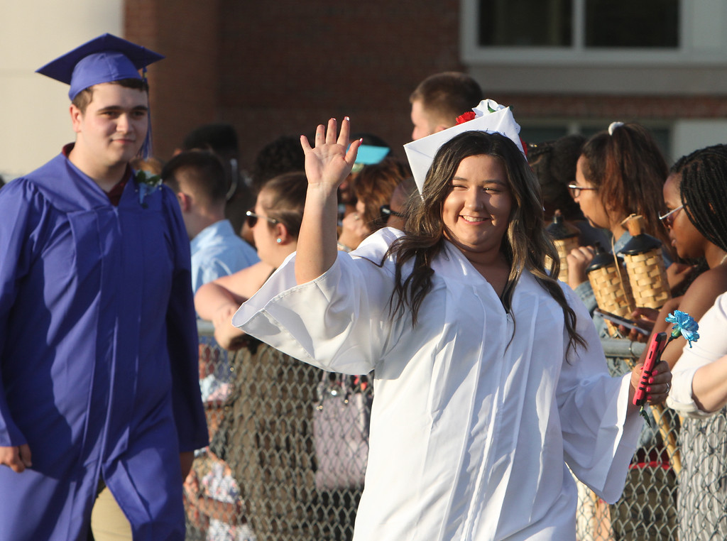 . Dracut High graduation. Kailyn Kerrigan, right, and Corey Kosowicz, left. (SUN/Julia Malakie)