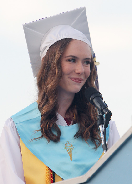 . Megan Tyler gives salutatory address at Dracut High graduation. (SUN/Julia Malakie)
