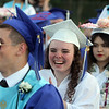 From left, Kyle Durkin, Ella Hinxman and Han Le at Dracut High graduation. (SUN/Julia Malakie)