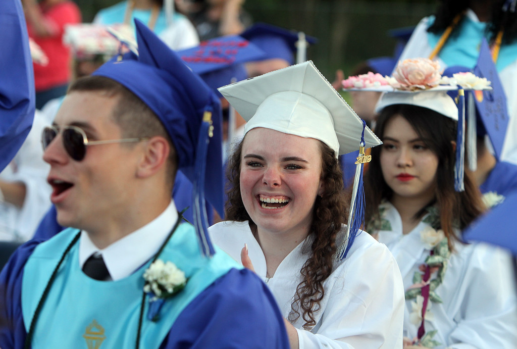 . From left, Kyle Durkin, Ella Hinxman and Han Le at Dracut High graduation. (SUN/Julia Malakie)
