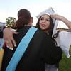 Dracut High graduation. Sophia Coakley hugs Spanish teacher Christine Lord. (SUN/Julia Malakie)