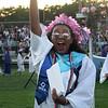 Dracut High graduation. Gabi Brown waves to the crowd after getting her diploma. (SUN/Julia Malakie)