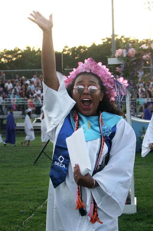 . Dracut High graduation. Gabi Brown waves to the crowd after getting her diploma. (SUN/Julia Malakie)
