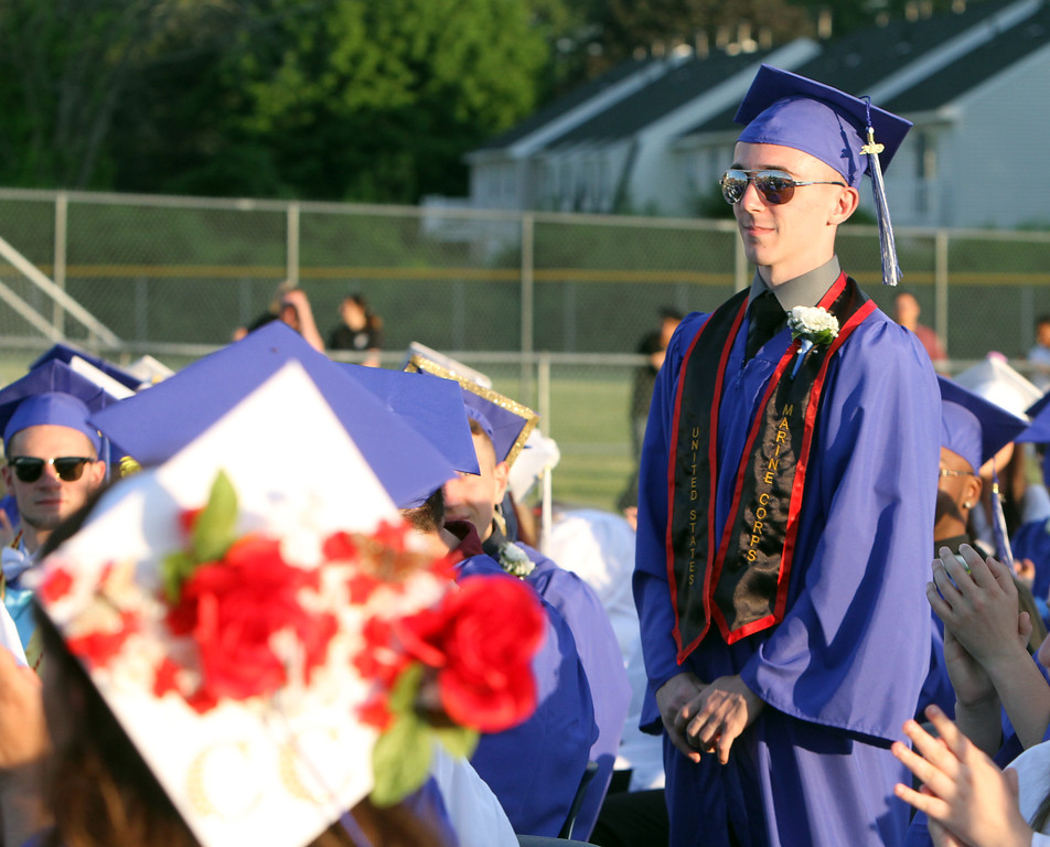 . Kyle McCullough, who is joining the Marines, is recognized at Dracut High graduation. (SUN/Julia Malakie)