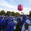 Graduates watch a giant beachball at Dracut High graduation. (SUN/Julia Malakie)