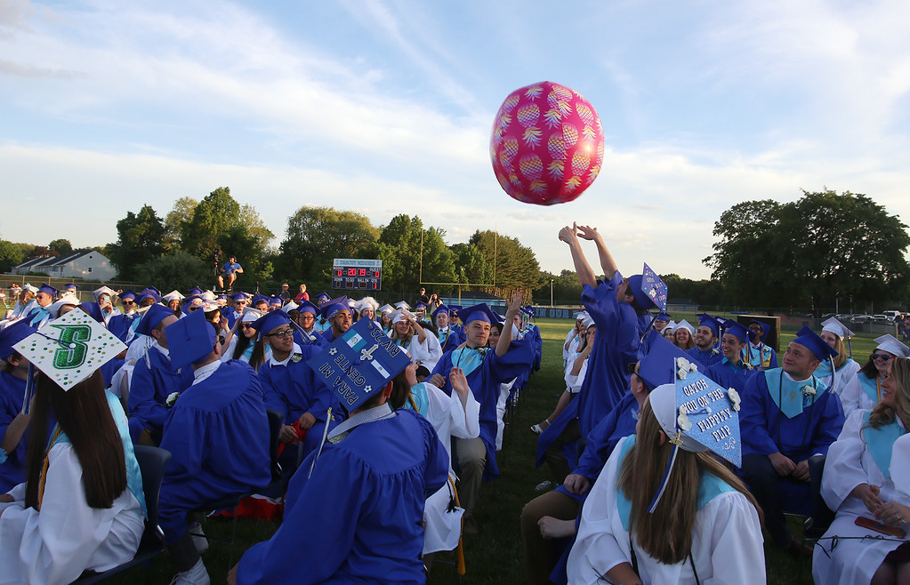 . Graduates watch a giant beachball at Dracut High graduation. (SUN/Julia Malakie)