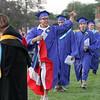 Javier Faria carries a Puerto Rican flag at Dracut High graduation. (SUN/Julia Malakie)