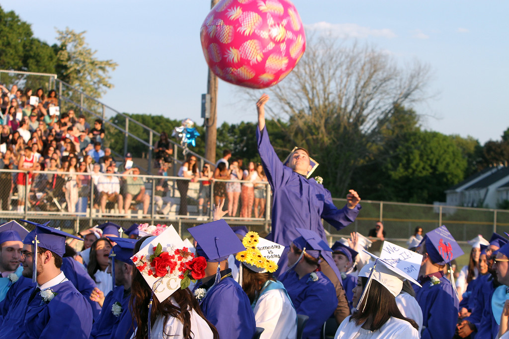 . Dracut High graduation. Graduates play with a larger than normal beach ball. (SUN/Julia Malakie)
