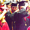 Will Fehlinger | The Herald-Tribune<br /> Members of the East Central High School graduating class of 2018 flip their tassels toward the end of the June 3 commencement ceremony.