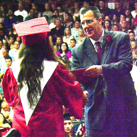 Will Fehlinger | The Herald-Tribune<br /> East Central High School superintendent Dr. Andrew Jackson granted diplomas at commencement exercises June 3.