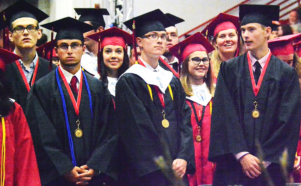 Will Fehlinger | The Herald-Tribune<br /> A group of East Central High School graduates watch the live broadcast of Sunday's commencement ceremony. Sunday marked the St. Leon institution's 45th commencement exercises.