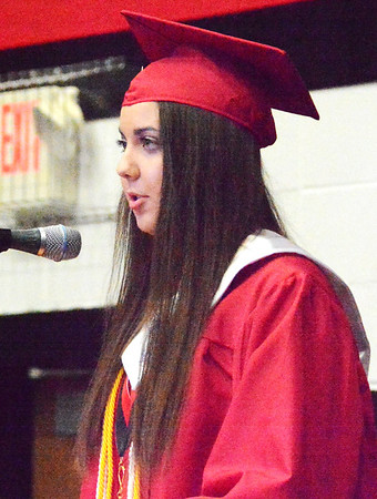 Will Fehlinger | The Herald-Tribune<br /> East Central High School's senior class president, Lauryn Helton, sends encouraging words to her graduating classmates at Sunday's commencement ceremony.