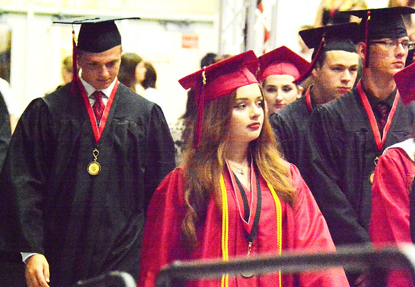 Will Fehlinger | The Herald-Tribune<br /> Seniors at East Central High School file into the school gymnasium during the opening processional for graduation 2018.