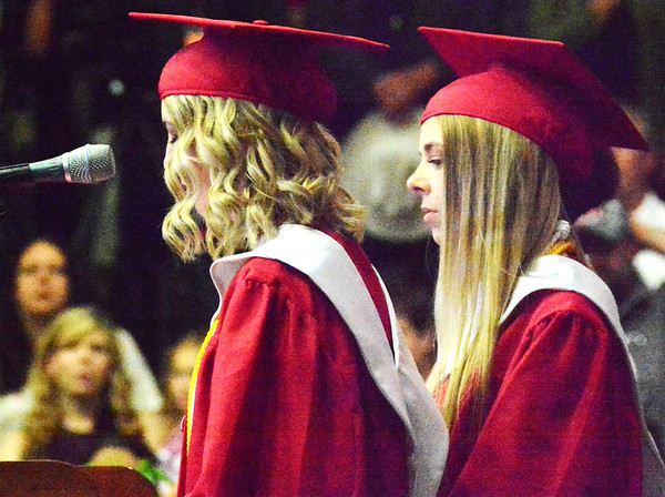 Will Fehlinger | The Herald-Tribune<br /> Sydney Hornberger and Cameron Poindexter lead the East Central High School Class of 2018 in the Pledge of Allegiance and moment of silence at commencement ceremonies June 3.