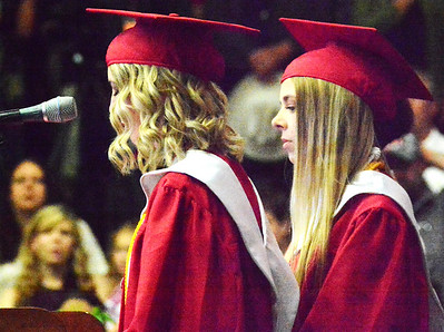 Will Fehlinger | The Herald-Tribune Sydney Hornberger and Cameron Poindexter lead the East Central High School Class of 2018 in the Pledge of Allegiance and moment of silence at commencement ceremonies June 3.