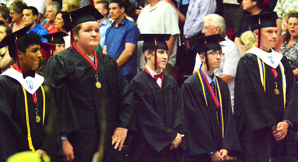 Will Fehlinger | The Herald-Tribune<br /> A row of East Central High School graduates takes in applause during commencement exercises June 3.