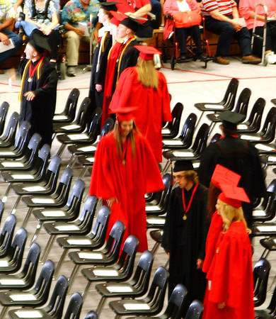 "Sarah Dougan | The Herald-Tribune<br /> Graduates walked in and took their seats as ""Pomp and Circumstance"" was played by the school's band."
