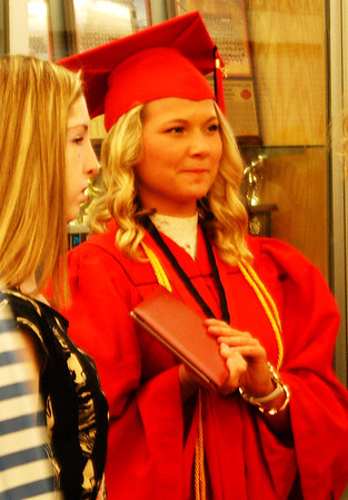 Sarah Dougan | The Herald-Tribune<br /> Graduate Tori Spangler waited outside the Activity Center to see her friends and family after the ceremony. She plans to attend Ball State and study nursing in the fall.