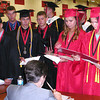 Diane Raver | The Herald-Tribune<br /> ECHS GRADUATES wait in line in the fieldhouse following the ceremony to receive their actual diplomas.