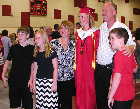 Diane Raver   The Herald-Tribune<br /> COLOR COORDINATED: One female graduate's family got behind the red-and-black school color scheme.