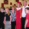 Diane Raver | The Herald-Tribune<br /> COLOR COORDINATED: One female graduate's family got behind the red-and-black school color scheme.
