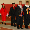 Diane Raver | The Herald-Tribune<br /> SAYING GOODBYE: For some new grads, Sunday may be the last time they were at the school.