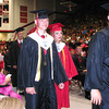 Diane Raver | The Herald-Tribune<br /> SENIORS HEAD to the stage as their names are called to receive their diplomas from superintendent Dr. Jeff Hendrix and be congratulated by principal Bob Shipley.