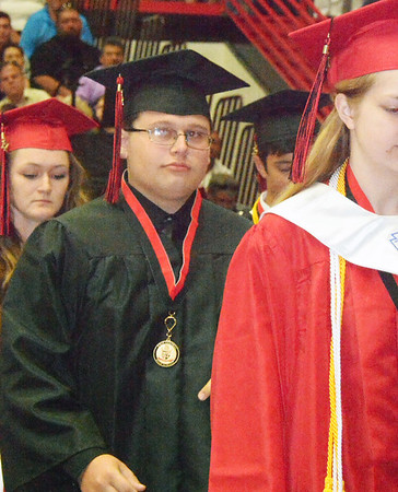 Will Fehlinger | The Herald-Tribune<br /> East Central High School graduates file to the front to receive diplomas on Sunday, June 4.
