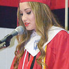 Will Fehlinger | The Herald-Tribune<br /> East Central High School student body President Bryssa Helton presents her address at the school's commencement ceremony.