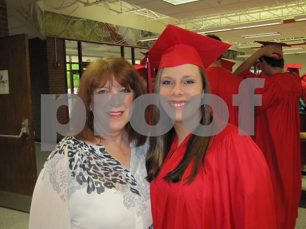 Instructor Deb Orozco poses with Dallas Smith before the graduates line up for the ceremony at Fort Dodge Senior High.