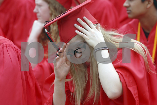 -Messenger photo by Hans Madsen<br /> <br /> Kellsea Williams has a little trouble with her cap in the breeze during the Fort Dodge Senior High commencement in Dodger Stadium Sunday afternoon.