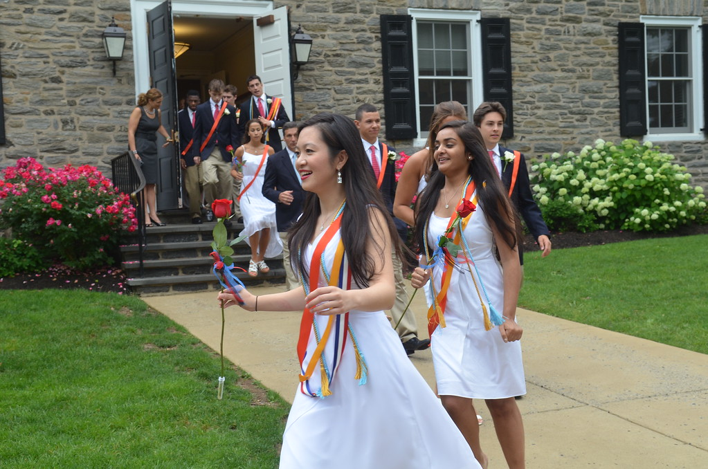 . Germantown Academy High School graduates proceed to the field house for commencement ceremony.   Friday, June 13, 2013.  Photo by Geoff Patton
