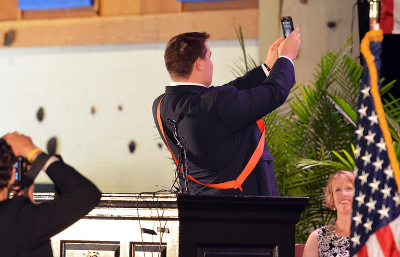 Germantown Academy Hgh School class of 2014 speaker John Dean takes a moment to shoot a selfie  before speaking at commencement ceremony.   Friday, June 13, 2013.  Photo by Geoff Patton