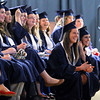 Record-Eagle/Keith King<br /> Graduating seniors laugh as they watch a presentation of pictures during the Grand Traverse Academy commencement exercises.