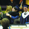 Special to the Record-Eagle/Mark O'Shaughnessy<br /> St. Francis band director Natalie Sears congratulates graduating members of the school's orchestra Sunday during graduation in Traverse City.