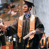 Record-Eagle/Keith King<br /> Jeff Comerford walks during the presentation of diplomas during the Traverse City Central High School commencement at the Interlochen Center for the Arts.