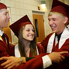 Special to the Record-Eagle/ Heather Rousseau <br /> (From left) John Galloup, Jenna Finney and James Heersema, all 18, share in their excitement before their graduation ceremony with Traverse City Christian School at East Bay Calvary Church.