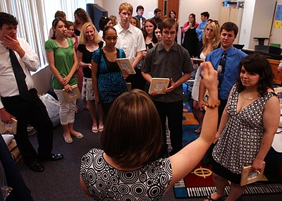 Record-Eagle/Tyler Sipe<br /> Grand Traverse Academy principal Allyson Apsey instructs the 33 graduating seniors on the order of the cereomony prior to Friday evening's commencement at the G.T.A. campus.