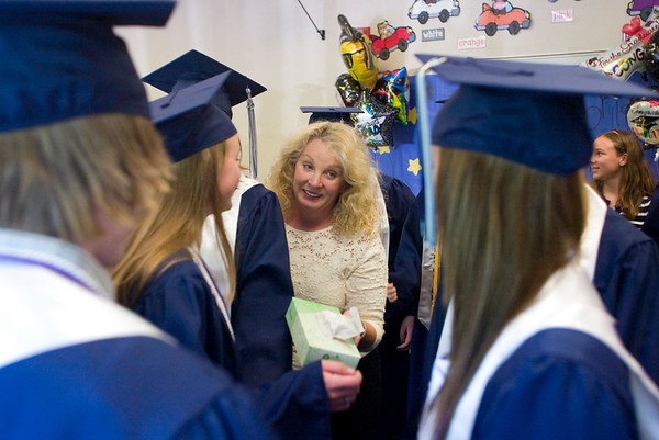 Record-Eagle/Jan-Michael Stump<br /> Grand Traverse Academy superintendent Kaye Mentley (cq) offers tissues to students before the start of commencement exercises Friday night.