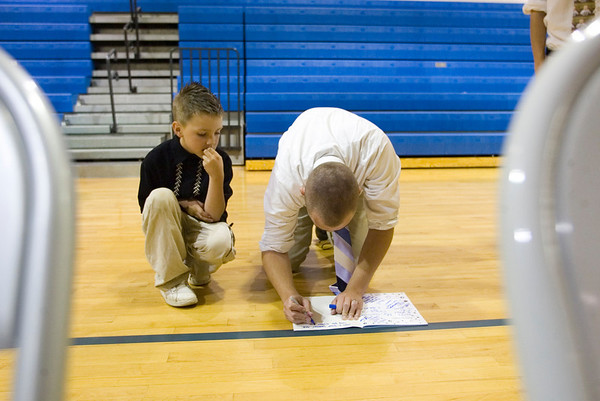 Record-Eagle/Jan-Michael Stump<br /> Grand Traverse Academy senior Mike Brakel (cq) signs a yearbook for fourth grader Kam Suzpek (cq) before the start of commencement exercises Friday night in the gymnasium.