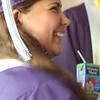 Record-Eagle/Sarah Brower<br /> Thiare Saa Garcia drinks a juice box before graduating.