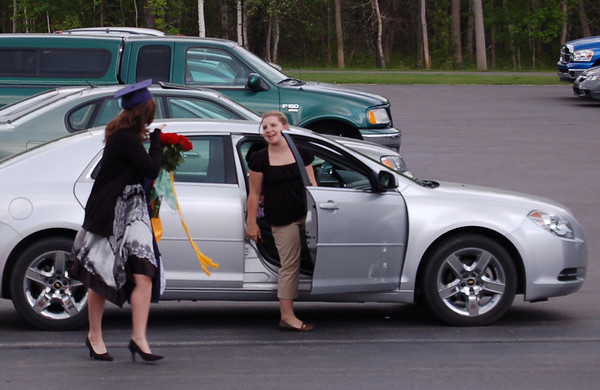 Record-Eagle/Sarah Brower<br /> A senior receives flowers after the ceremony.