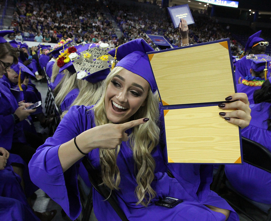 . Greater Lowell Tech graduation. Cosmetology graduate Nicole Justo of Lowell hold up her empty diploma case. She thinks they\'re empty so there won\'t be any demonstrations during graduation. (SUN/Julia Malakie)
