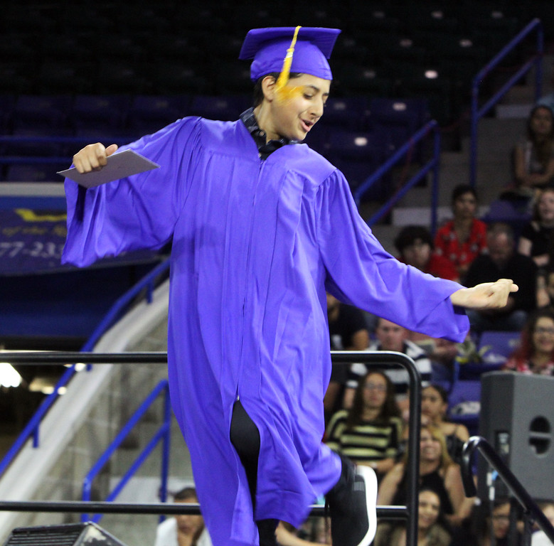 . Greater Lowell Tech graduation. Automotive Technology graduate Ibrahim Abbas of Lowell dances his way across the stage. (SUN/Julia Malakie)