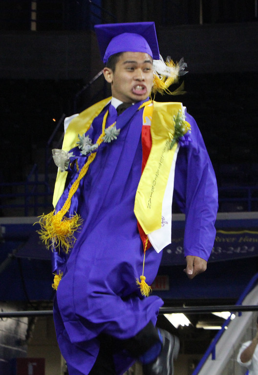 . Greater Lowell Tech graduation. Salutatorian Jaenald Javier does a dance as he goes to get his diploma. (SUN/Julia Malakie)